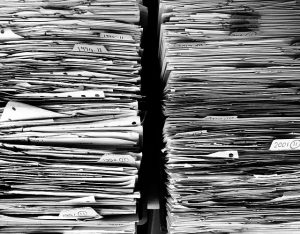 Two stacks of paper documents